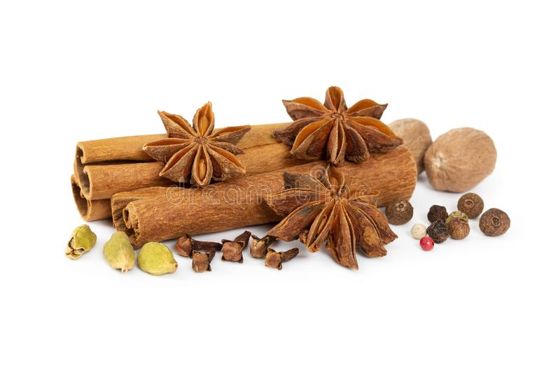 Cinnamon, star anise, cardamom, nutmeg, cloves and mixture of peppers stock image