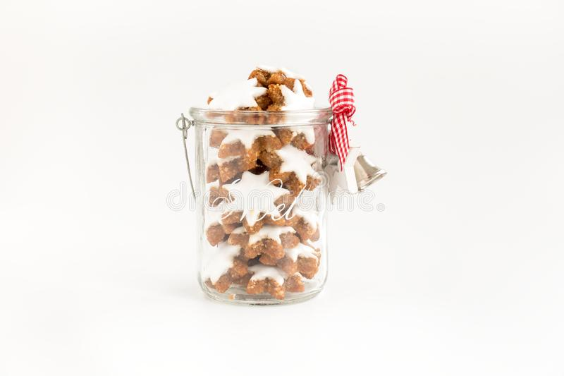 Cinnamon Stars, German Zimtsterne in a Glass Jar with Christmas Decoration royalty free stock photography