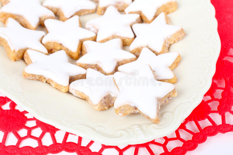 Cinnamon stars on red stock photography