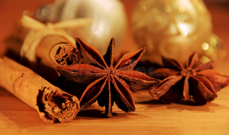 Cinnamon stick and star from anis. Christmas time royalty free stock images
