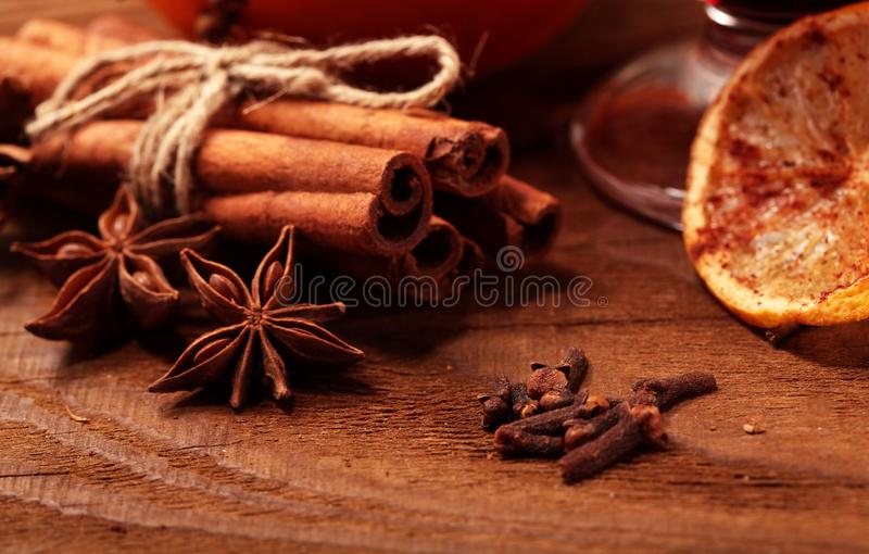 Cinnamon stick and star anise spice on wooden background macro. Cinnamon stick and star anise spice on wooden background macro royalty free stock photography