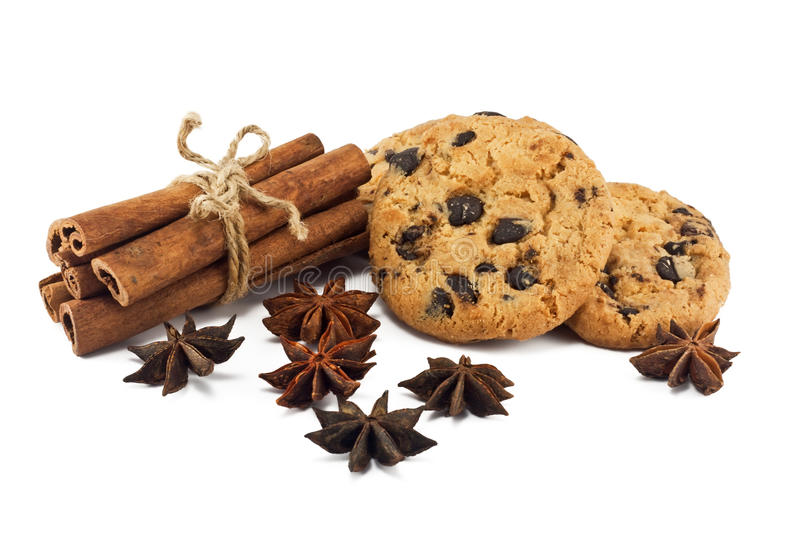 Cinnamon sticks, anise and chocolate chips cookies royalty free stock images