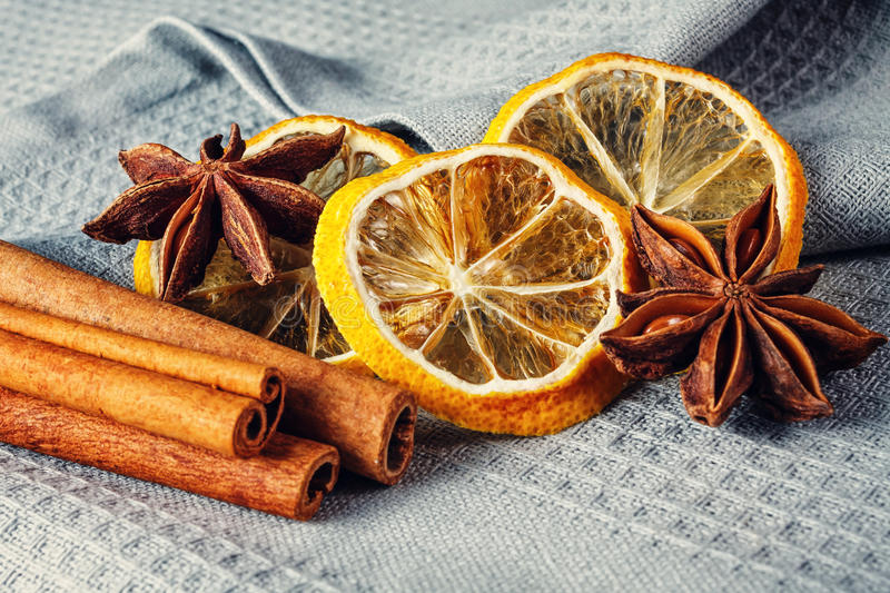 Cinnamon sticks, anise stars and sliced of dried citrus royalty free stock photo
