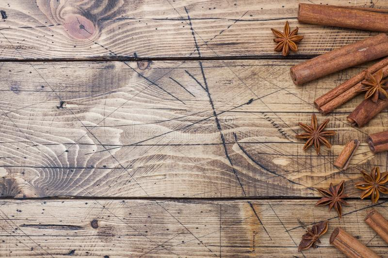 Cinnamon sticks and anise stars on wooden background. Copy space. Top view royalty free stock photography