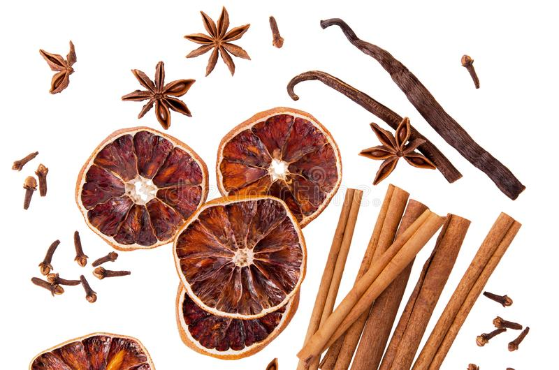 Cinnamon sticks, anise, vanilla and dry orange round slices isolated on white background as Christmas spice set for mulled wine,. Cinnamon sticks, anise, vanilla royalty free stock photo