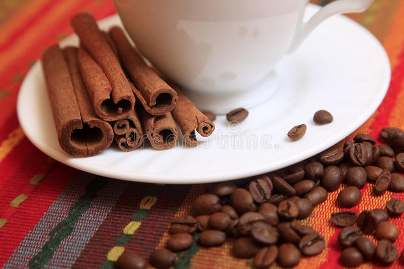 Cinnamon sticks with coffee royalty free stock photos