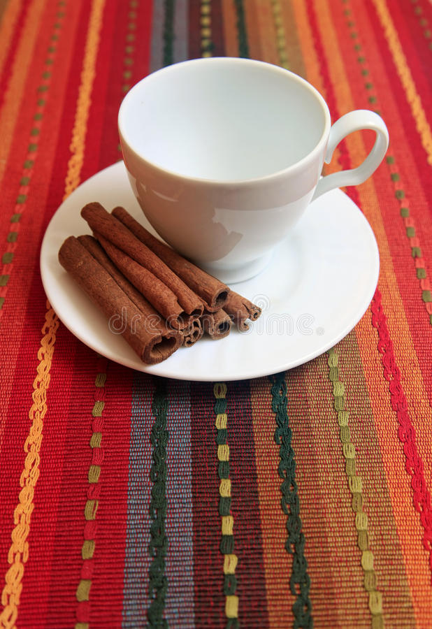 Cinnamon sticks with cup royalty free stock photos