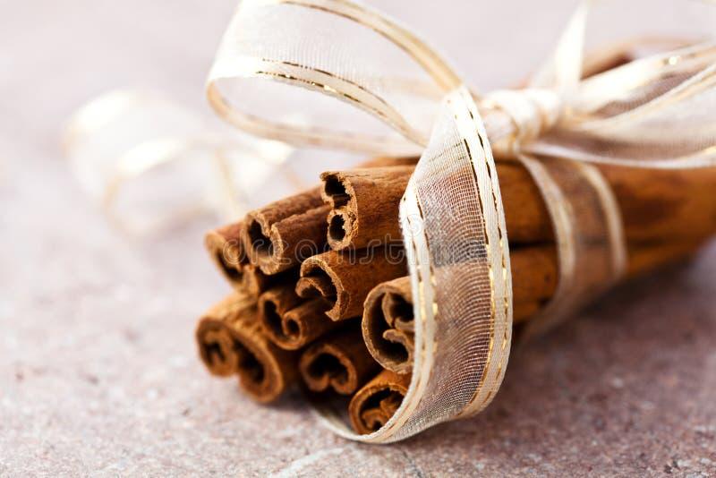 Cinnamon sticks with decorative ribbon stock photography
