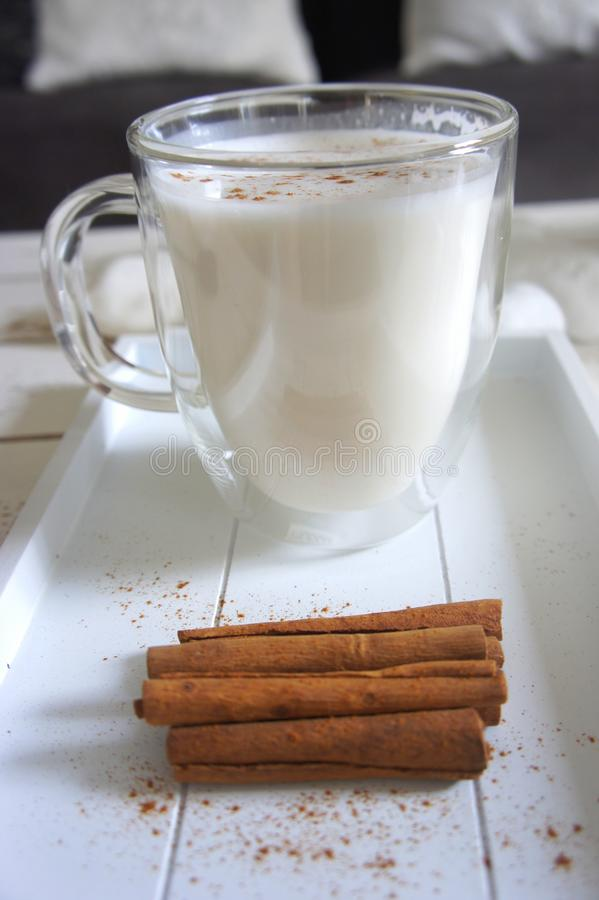 Cinnamon Sticks beside the Glass of Milk royalty free stock photo