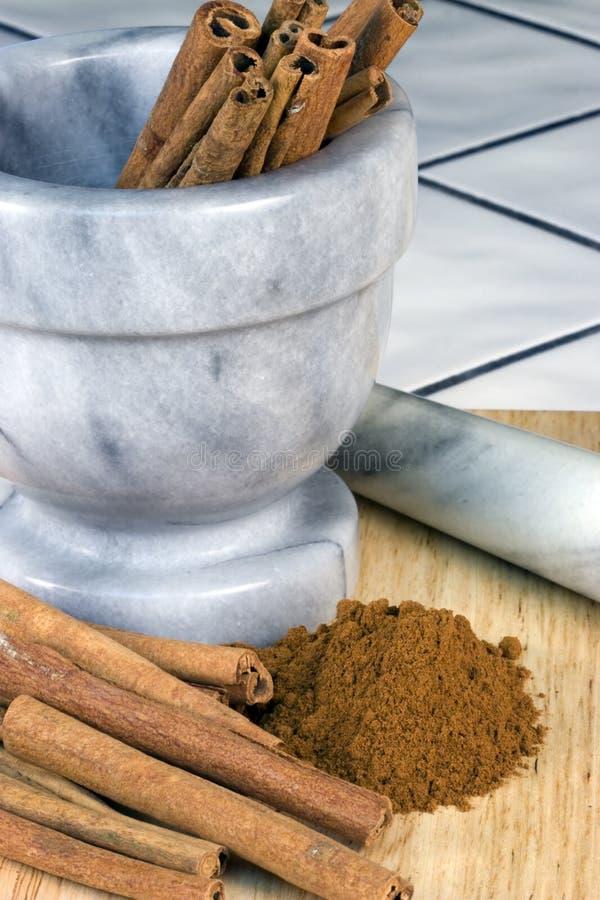 Cinnamon Sticks, Mortar Royalty Free Stock Photo