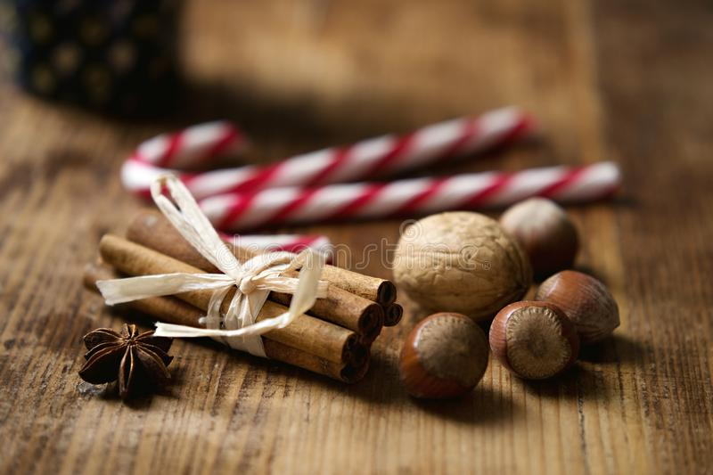 Cinnamon sticks with nuts and spices stock images