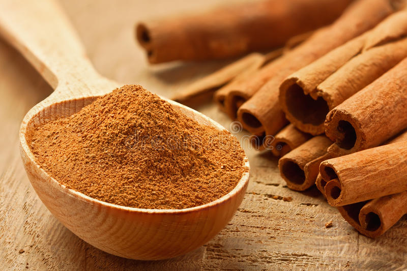 Cinnamon sticks and powder royalty free stock photography