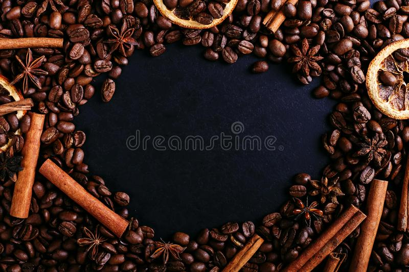 Cinnamon sticks, star anise, coffee beans and dried orange on the kitchen table. Fragrant spices for coffee drink, close-up stock photos