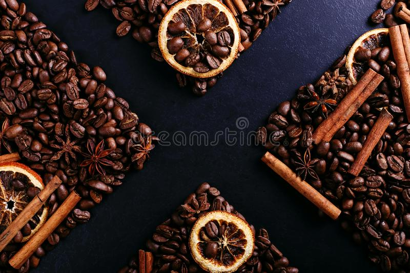 Cinnamon sticks, star anise, coffee beans and dried orange on the kitchen table. Fragrant spices for coffee drink, close-up stock images