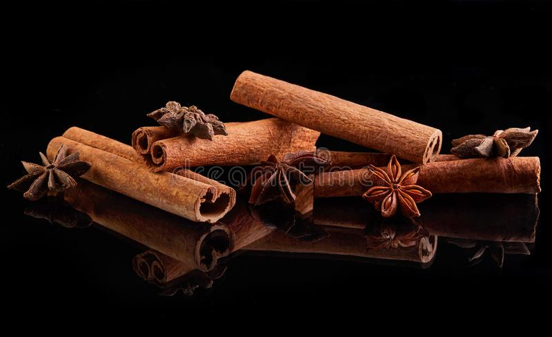 Cinnamon sticks and star anise isolated on black. Background, spice, white, aroma, food, ingredient, natural, seasoning, brown, cooking, dry, flavor, culinary stock image