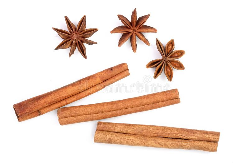 Cinnamon sticks and star anise isolated on white background. Top view royalty free stock images