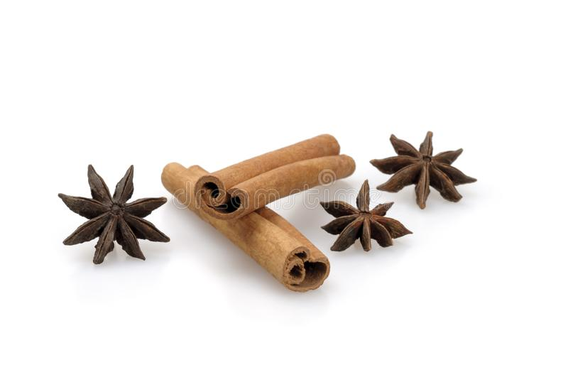 Cinnamon sticks and star anise stars on a white background. Close-up, isolated. Fragrant spices stock image