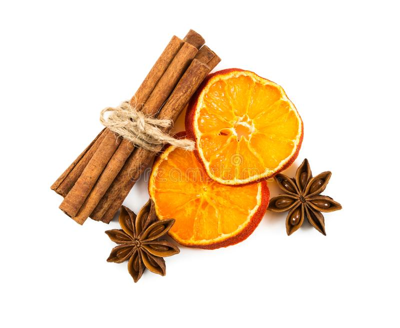 Cinnamon sticks tied with string, slices of dried orange and sta royalty free stock photos