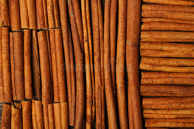 Cinnamon sticks on wooden background stock images