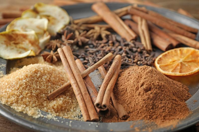 Cinnamon and sugar on plate, closeup royalty free stock images