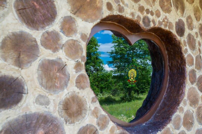 Heart shaped window on local ecumenical chape royalty free stock photos