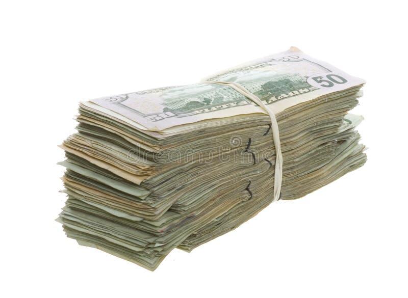 Cinqüênta contas de dólar empilhadas e unidas junto fotos de stock