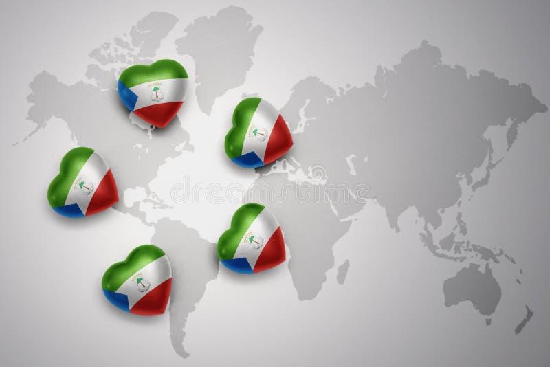 Cinq coeurs avec le drapeau national de la Guinée équatoriale sur un fond de carte du monde illustration libre de droits