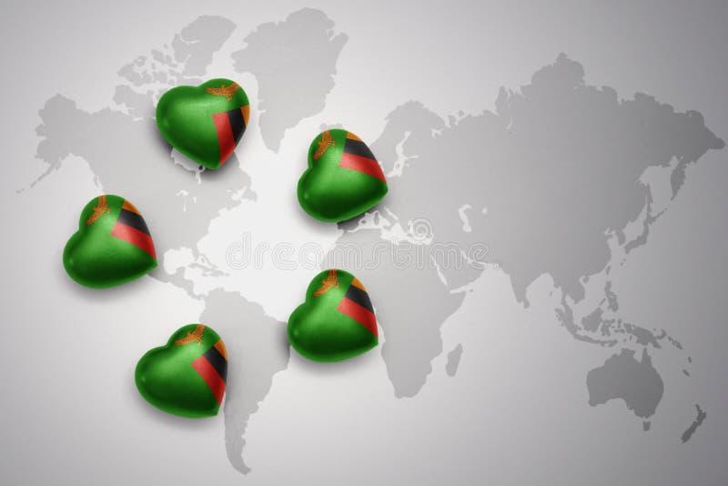 Cinq coeurs avec le drapeau national de la Zambie sur un fond de carte du monde illustration de vecteur