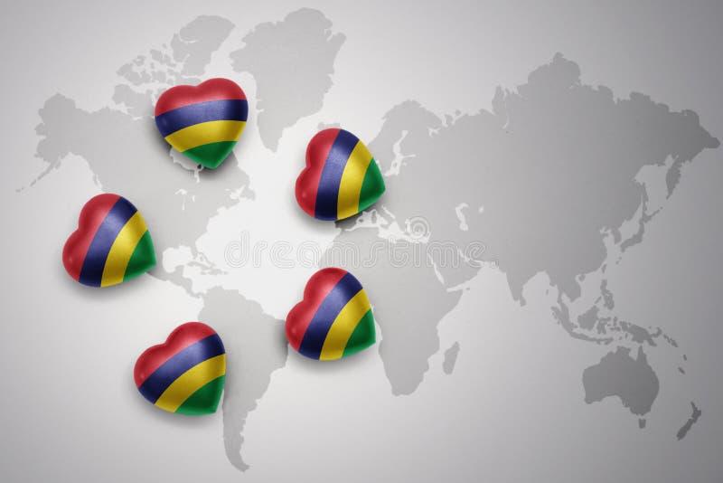 Cinq coeurs avec le drapeau national des îles Maurice sur un fond de carte du monde illustration libre de droits