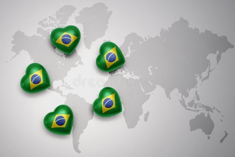 cinq coeurs avec le drapeau national du Brésil sur un fond de carte du monde illustration stock