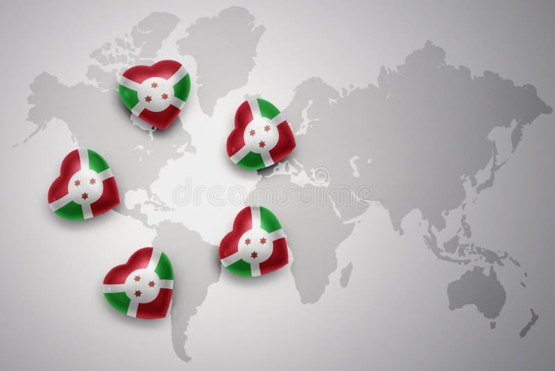 Cinq coeurs avec le drapeau national du Burundi sur un fond de carte du monde illustration stock