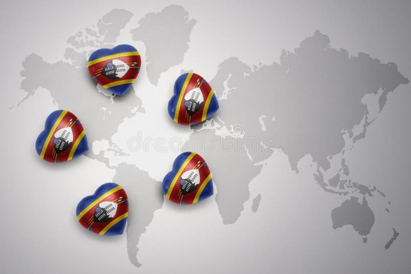 Cinq coeurs avec le drapeau national du Souaziland sur un fond de carte du monde illustration de vecteur