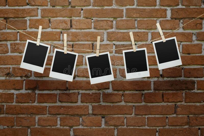 Foto in bianco sopra il muro di mattoni fotografie stock