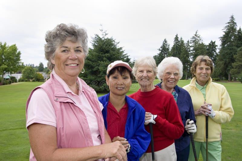 Cinque giocatori di golf felici fotografia stock