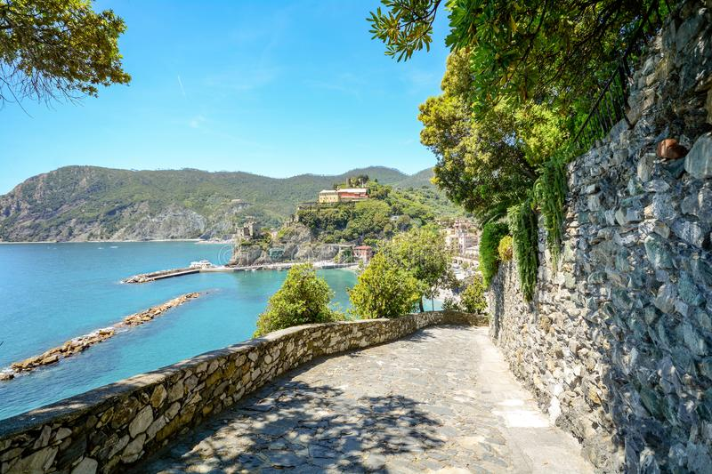 Cinque Terre: Hiking trail from Vernazza to Monterosso al Mare, hiking in early summer at Mediterranean landscape, Liguria Italy royalty free stock photo