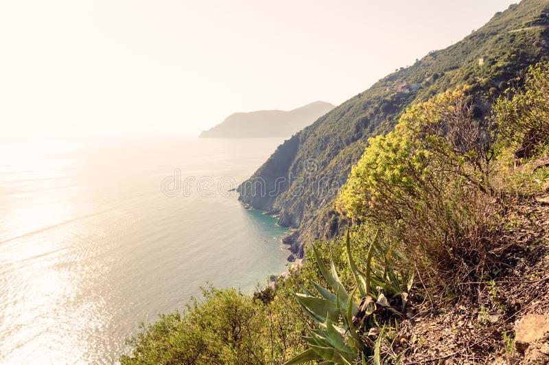 Cinque Terre, Italy - romantic travel destination with steep cliffs over sea and villages on hills royalty free stock photo
