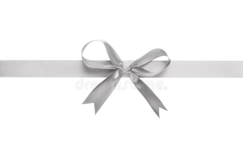 Cinta de plata con el arco para empaquetar foto de archivo libre de regalías