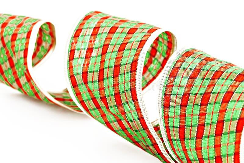 Cinta decorativa verde del embalaje aislada en una jaula imagen de archivo