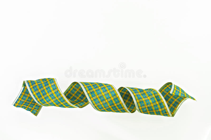 Cinta decorativa verde del embalaje aislada en una jaula imagen de archivo libre de regalías