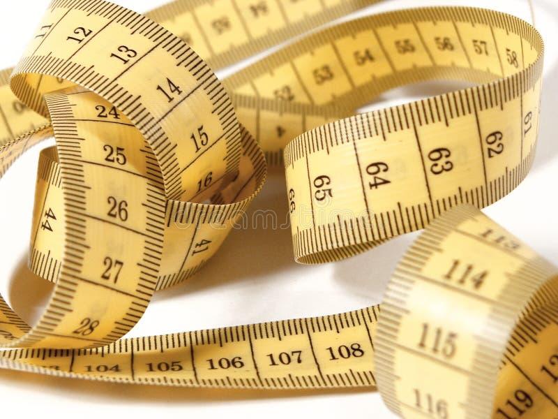 Cinta métrica amarilla en centímetros fotografía de archivo