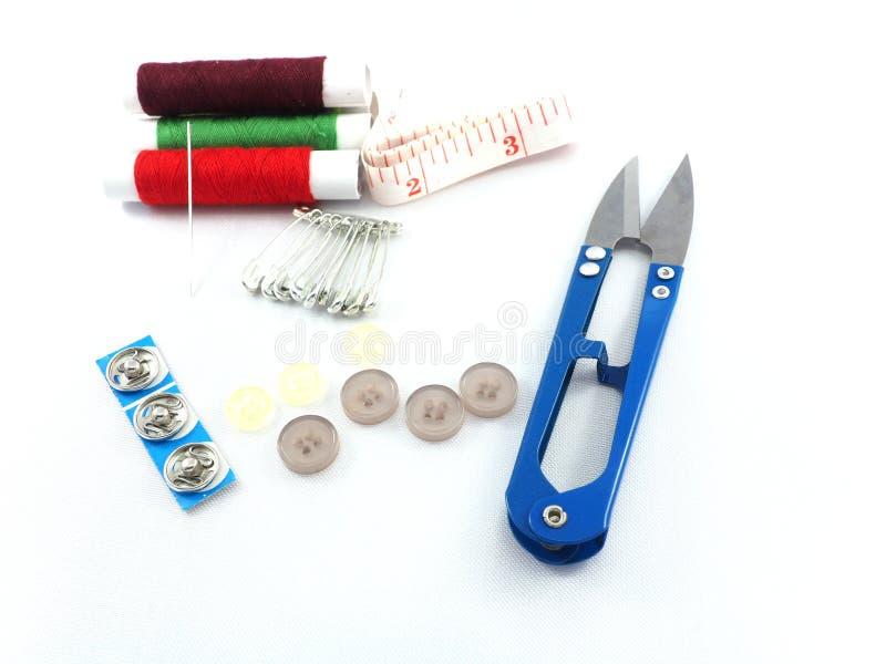Cinta métrica de la broche del botón de la aguja de costura foto de archivo