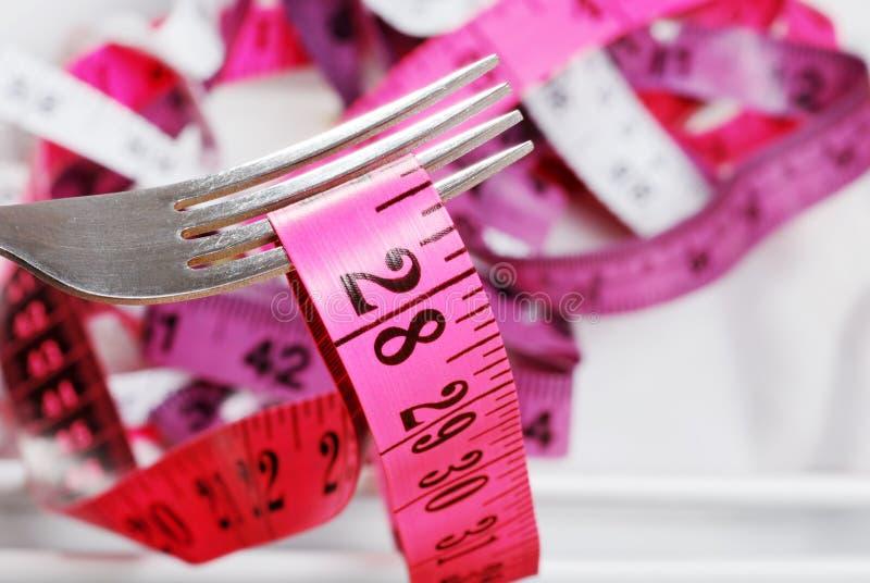 Cinta métrica rosada macra en fork imágenes de archivo libres de regalías