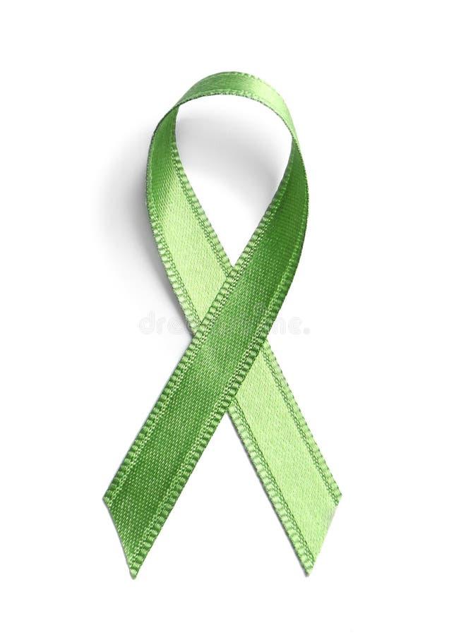 Cinta verde en el fondo blanco Conciencia del cáncer imágenes de archivo libres de regalías