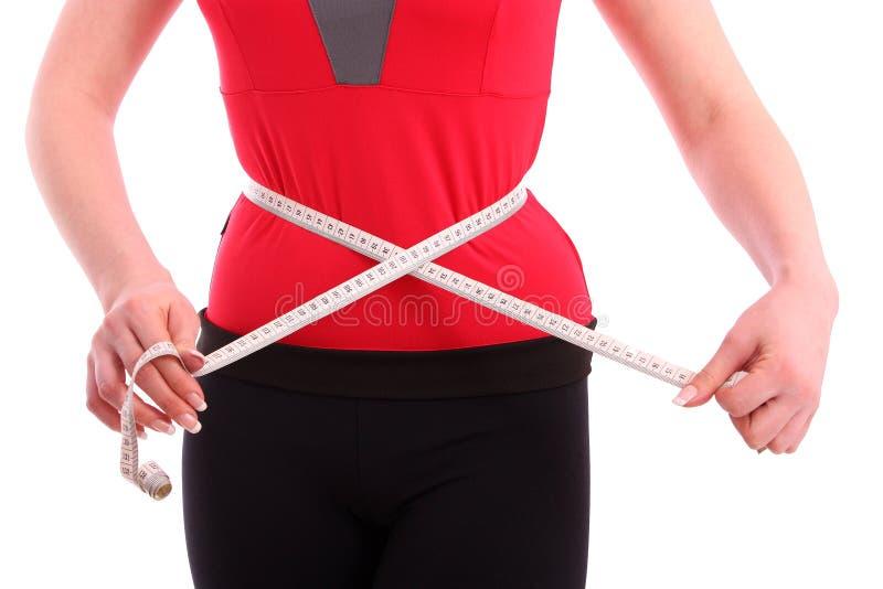 Cintura de la mujer con cinta métrica foto de archivo