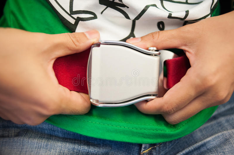Cintura di sicurezza con la mano fotografia stock