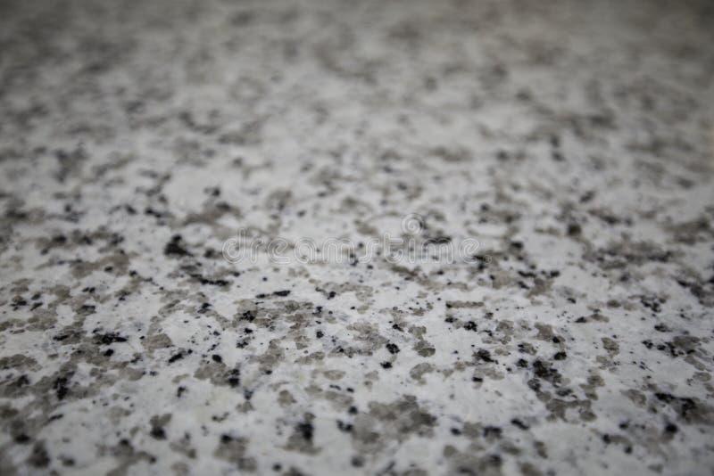 Cinza, Brown, e granito preto imagens de stock royalty free