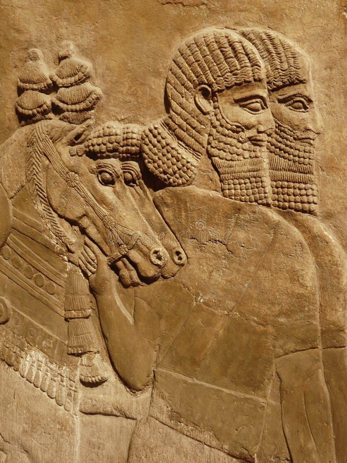 Cinzeladura Assyrian antiga da parede fotografia de stock royalty free