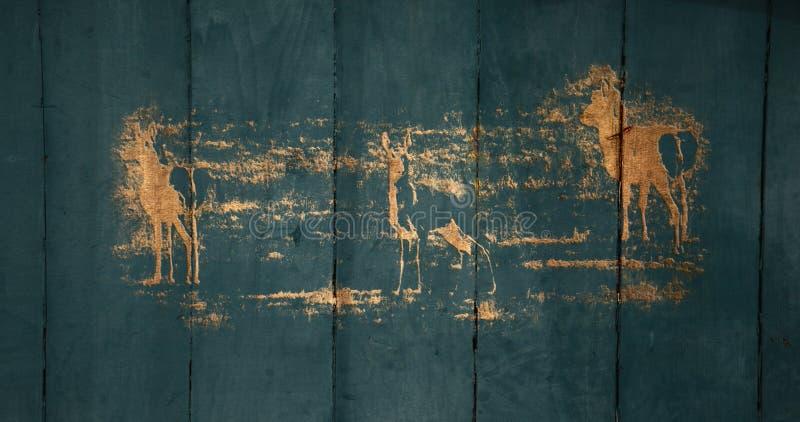 Cinzeladura na porta de celeiro velha fotografia de stock