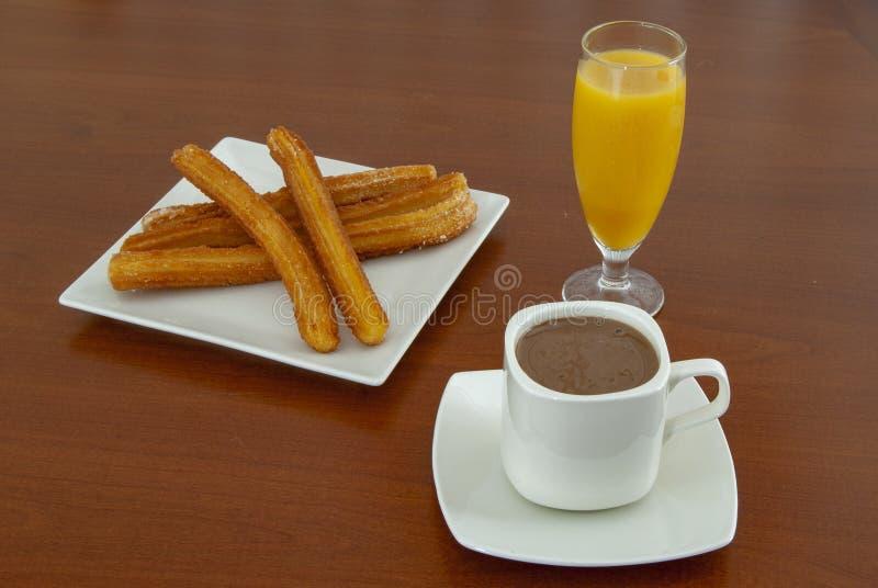 Cioccolata calda con i churros fotografie stock