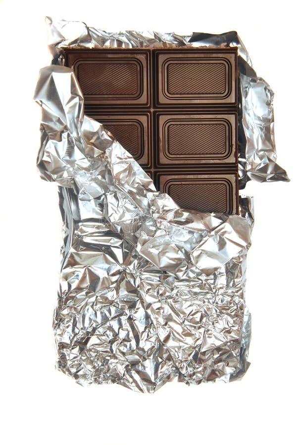 Cioccolato al latte in stagnola fotografie stock